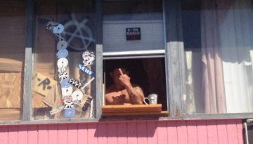 SHIRTLESS DOUCHE FROM WINDOW LEDGE