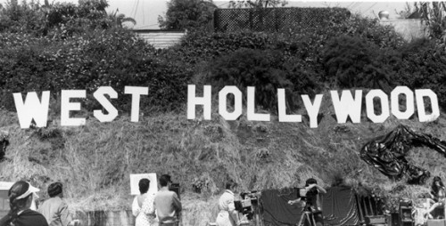 The West Hollywood sign is unveiled outside EZTV on April 15, 1986. (Photo courtesy of Sallie M. Fiske Papers and Photographs / ONE Archives at the USC Libraries.)
